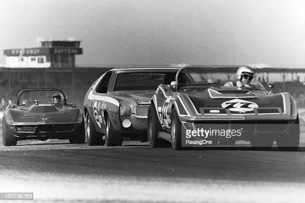 A pair of Chevrolet Corvettes sandwich an AMC Javelin during SCCA racing at Daytona International Speedway