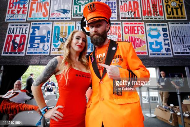 A pair of Cincinnati Bengals fans look on prior to the start of the first round of the NFL Draft on April 25 2019 in Nashville Tennessee