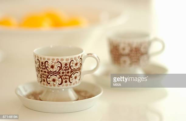 A pair of coffee cup