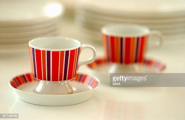 A pair of coffee cups