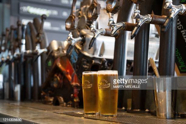 Pair of cold beers are pictured at the bar on the first day of re-opening after establishments were shut for two months due to the COVID-19...
