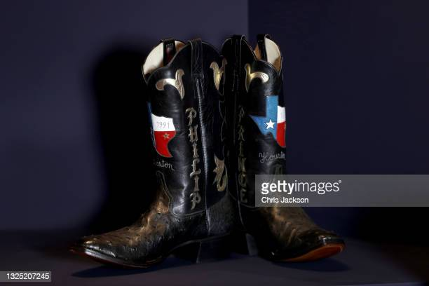 Pair of cowboy boots gifted to Prince Philip during a visit to Houston Texas in the Great Hall of Windsor Castle at an exhibition that commemorates...