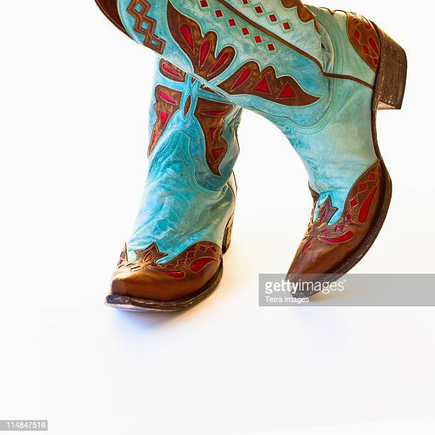 pair of cowboy shoes - cowboy boot stock pictures, royalty-free photos & images