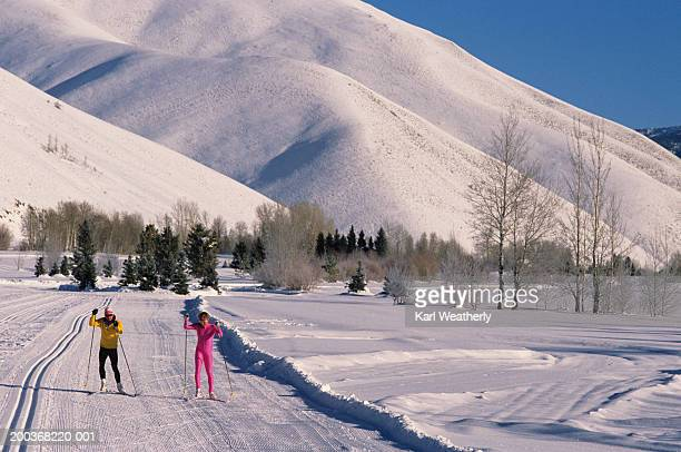 pair of cross-country skiers, sun valley, idaho, usa - sun valley idaho stock photos and pictures