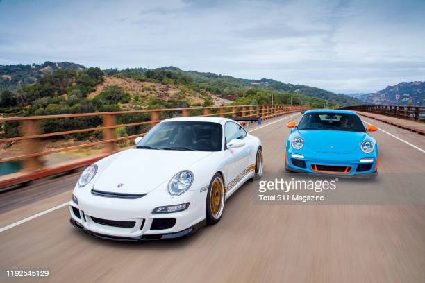 A pair of customtuned Porsche 911 sports cars including a 2011 9972 GT3 RS and 2007 9971 GT3 photographed near Fremont California on October 1 2018