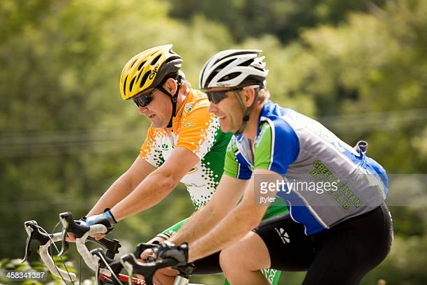 Pair of Cyclists Ringing Together