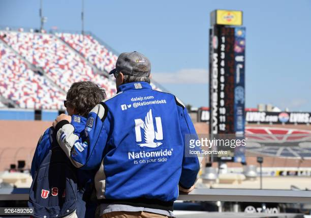 A pair of Dale Earnhardt Jr race fans watch Monster Energy NASCAR Cup Series practice from the Neon Garage March 02 2018 at Las Vegas Motor Speedway...