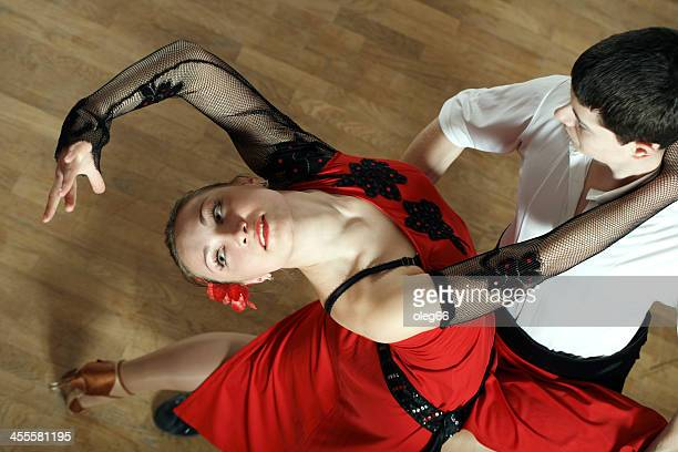 pair of dancers dancing latin dance - salsa dancing stock photos and pictures