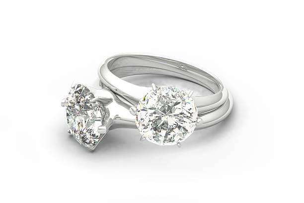 On White Pair Of Diamond Rings Isolated Background