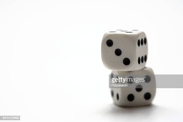 Pair of dice stacked, on white background