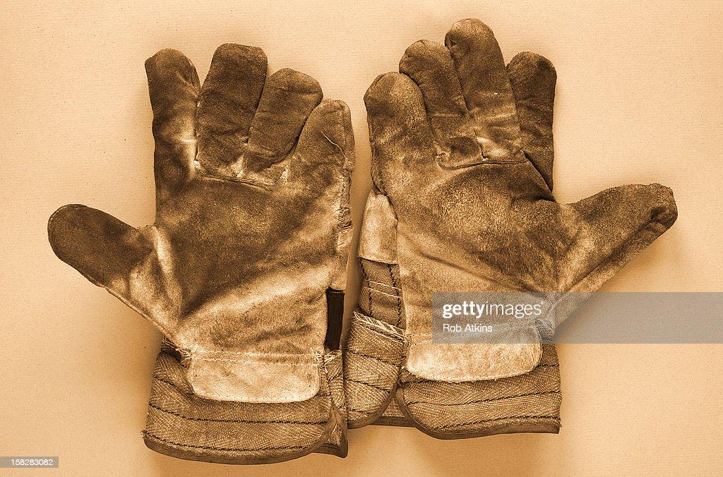 Pair of dirty work gloves : Bildbanksbilder