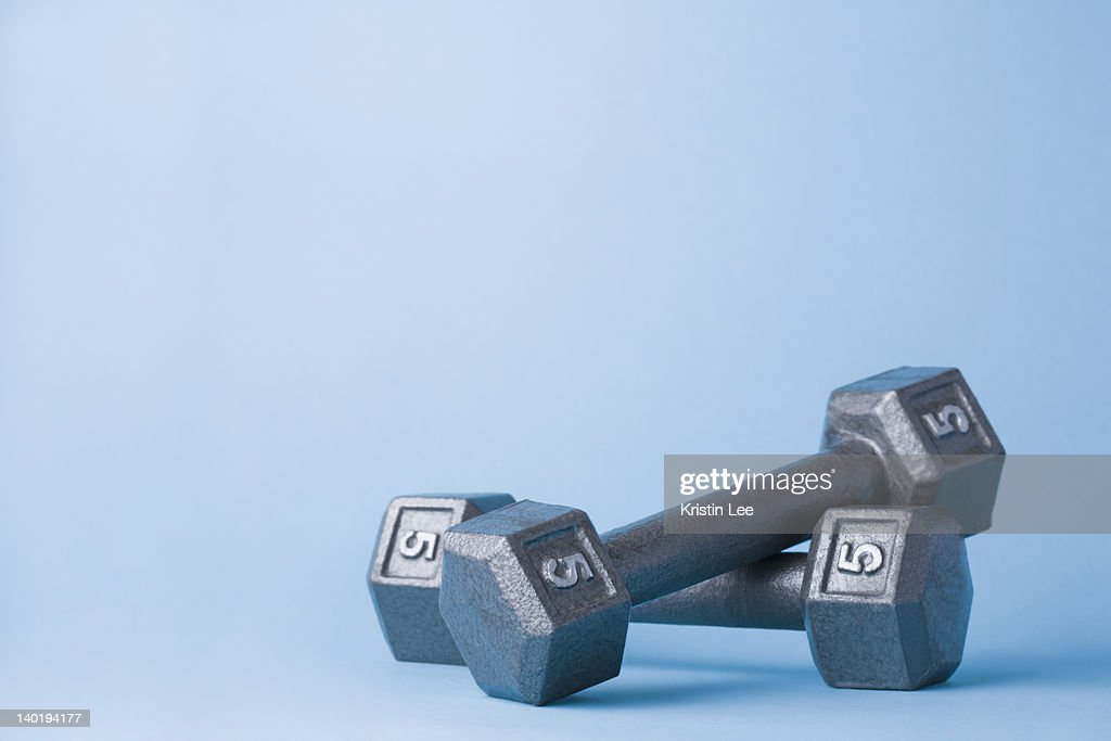 Pair of dumbbells on blue background : Stock Photo