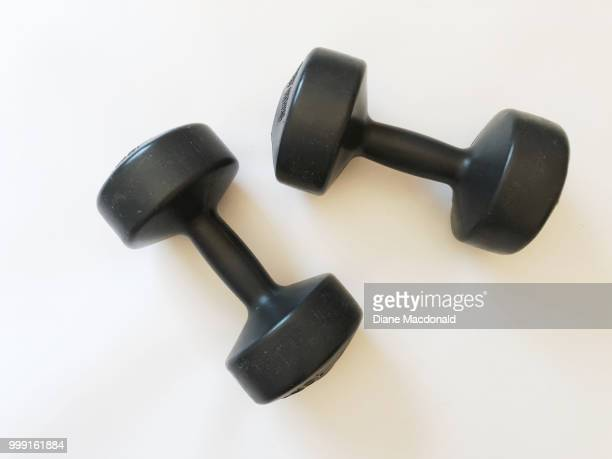 a pair of dumbbells - sports equipment stock pictures, royalty-free photos & images