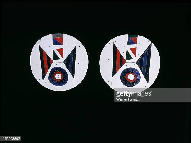 Pair of earrings made from coloured pieces of linoleum attached to a wooden disc Such earrings were made by migrant Zulu men working in South African...