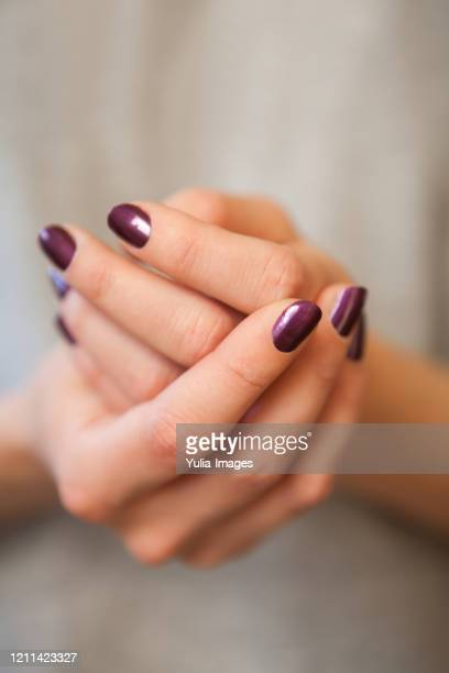 pair of elegant hands with purple nail paint - enamel stock pictures, royalty-free photos & images