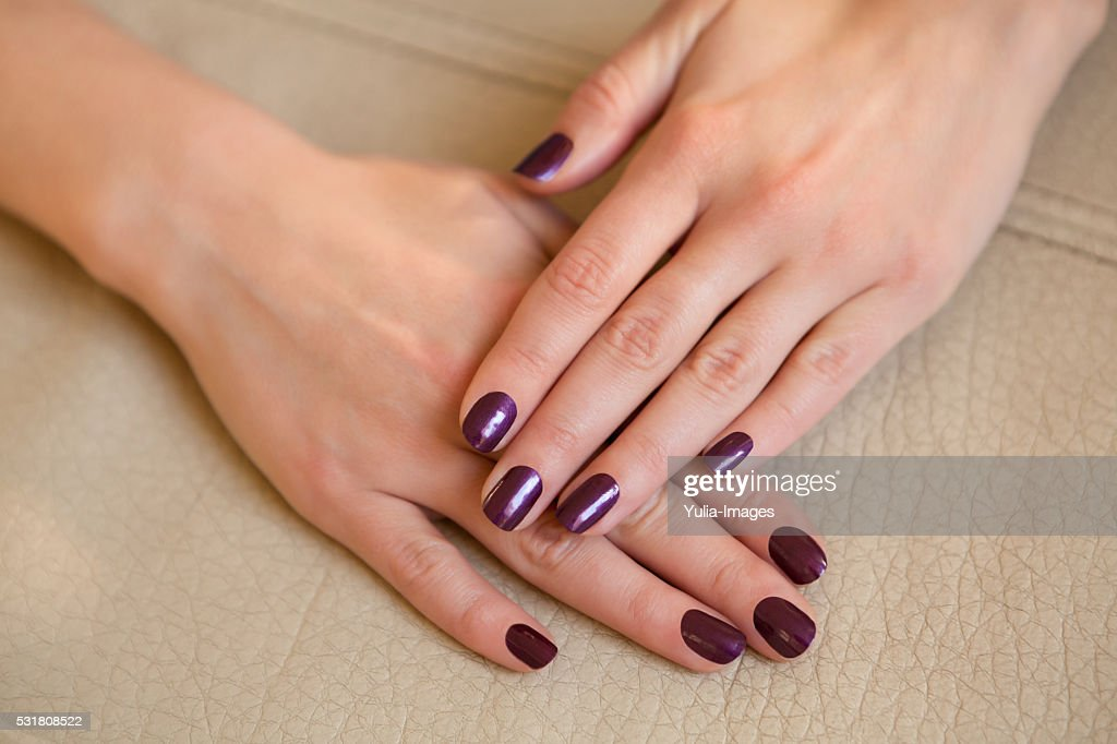 Pair Of Elegant Hands With Purple Nail Paint Stock Photo | Getty Images