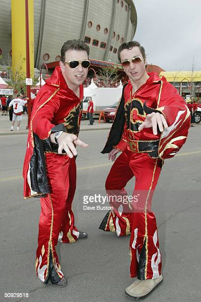 A pair of Elvis impersonating Calgary Flames' fans pose outside the Pengrowth Saddledome before the start of game six of the NHL Stanley Cup Finals...