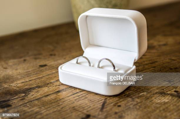 pair of engagement rings in white box - engagement ring box stock photos and pictures