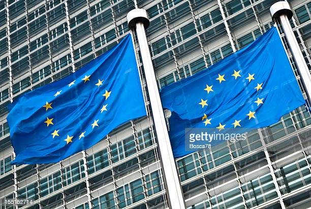 Pair of EU flags at European Commission, Brussels