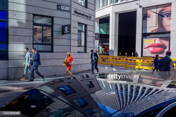 A pair of eyes and passersby on Fenchurch Street in the heart of the capital's financial district on 24th September 2018 in London England