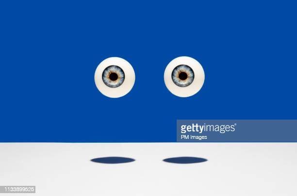 pair of eyes - big brother orwellian concept stock pictures, royalty-free photos & images