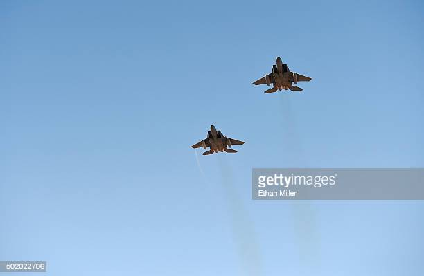 A pair of F15C fighter jets from Nellis Air Force Base perform a flyover before the Brigham Young Cougars and Utah Utes play in the Royal Purple Las...