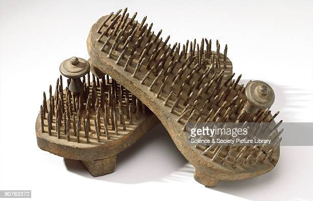 Pair of fakir's sandals with iron spikes through the soles and wooden toe pegs Made in India
