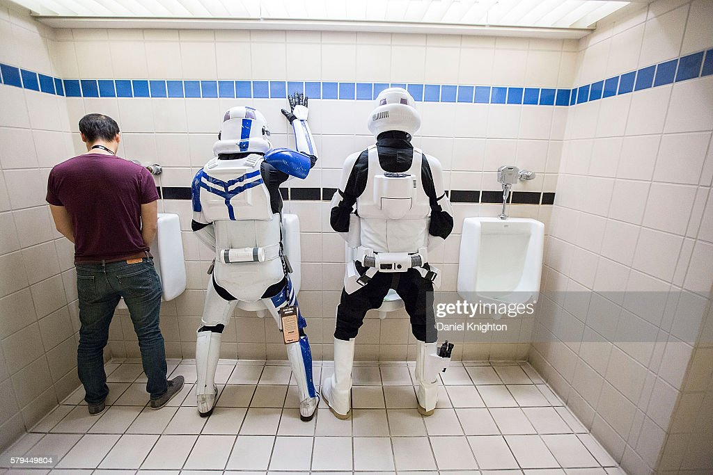 A pair of fans dressed as Star Wars stormtroopers pose for a photo in the restroom at Comic-Con International - Day 3 on July 22, 2016 in San Diego, California.