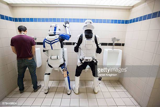 A pair of fans dressed as Star Wars stormtroopers pose for a photo in the restroom at ComicCon International Day 3 on July 22 2016 in San Diego...