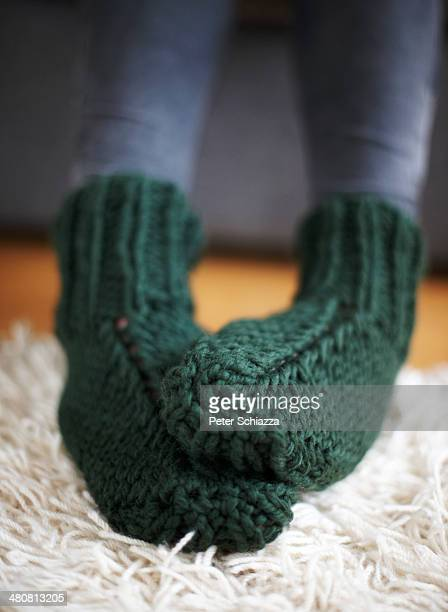 pair of feet in green knitted socks - thick white women stock photos and pictures