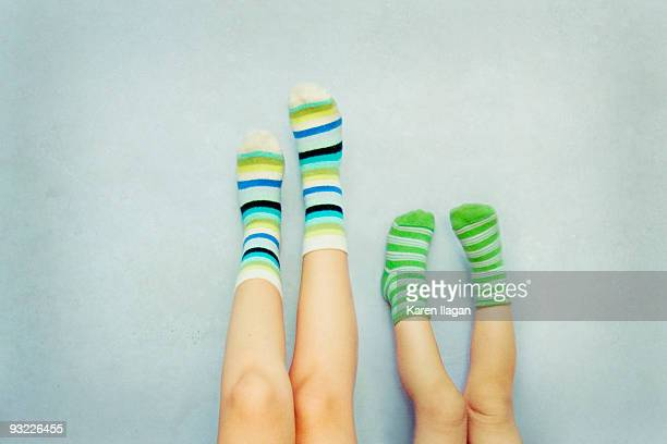 A pair of feet with striped Socks (Mother & Child)