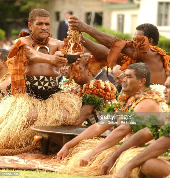 A pair of Fijian warriors prepare kava juice for the Prince of Wales at the village of Viseisei Banned in most of Europe and the United States the...
