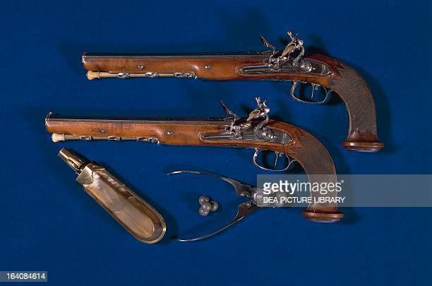 Pair of flintlock pistols from the Directory era with balls gunpowder holder and pliers France 18th century Paris Musée De L'Armée
