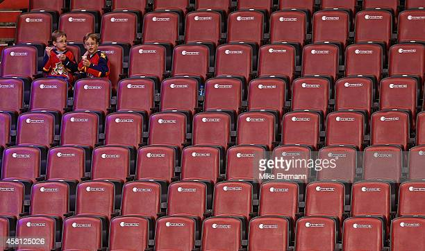 Pair of Florida Panthers fans look on during a game against the Arizona Coyotes at BB&T Center on October 30, 2014 in Sunrise, Florida.