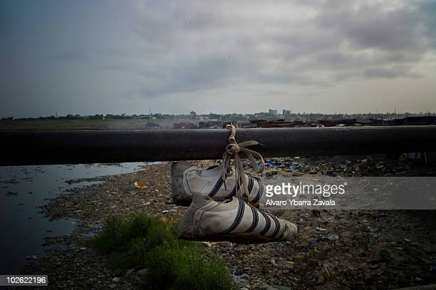 A pair of football boots hanging in the Agbogbloshie slum in Accra Ghana There are many young people in this area who play football and dream of...