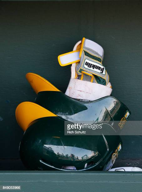 A pair of Franklin batting gloves sit in an Oakland Athletics's batting helmet before a game against the Philadelphia Phillies at Citizens Bank Park...