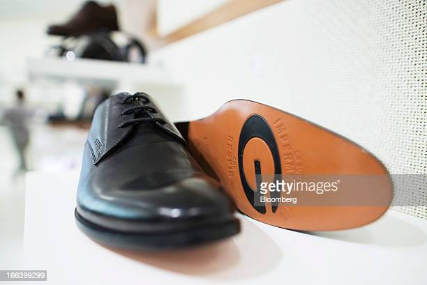 1283f1f352441 A pair of Geox SpA men s shoes are displayed for sale inside the company s  flagship store