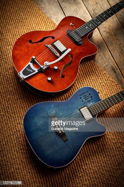 A pair of Godin electric guitars including an A6 Ultra with a Denim Blue Flame finish and a 5th Avenue Uptown Custom with a Havana Brown finish taken...