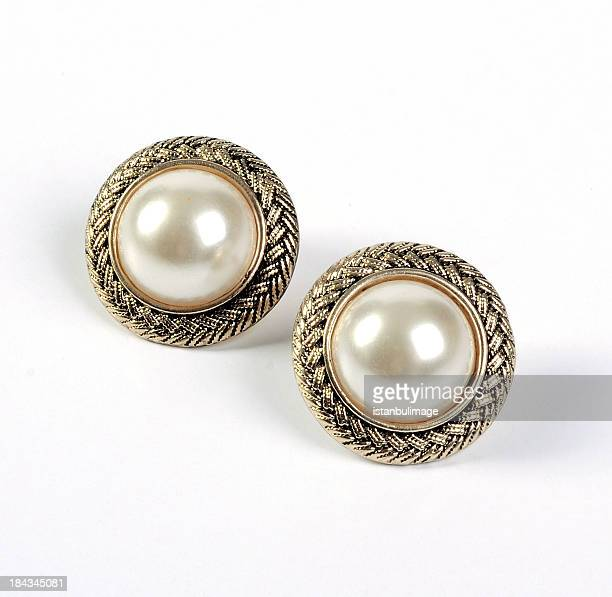 A pair of gold framed pearl stud earrings