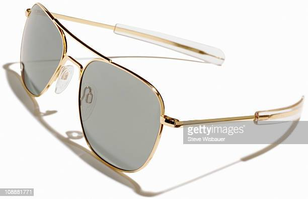 A pair of gold rimmed aviator sunglasses