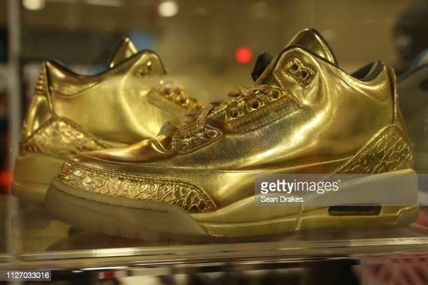 A pair of gold The Ushers valued at $25000 on display by Sarmiento Inc during SneakerCon 2019 at Fort Lauderdale Convention Center on February 2 2019...
