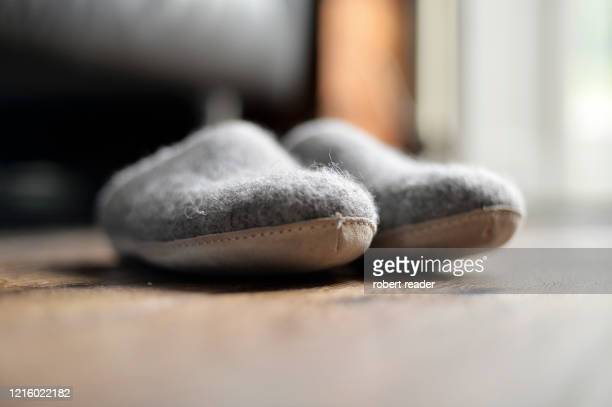 a pair of grey wool felt slippers - grey colour stock pictures, royalty-free photos & images