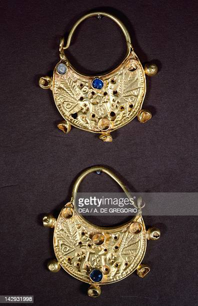 Pair of half-moon shaped earrings in the Byzantine style from Kruje, Albania. Greek civilization, 7th Century BC. Tirana, Museo Archeologico