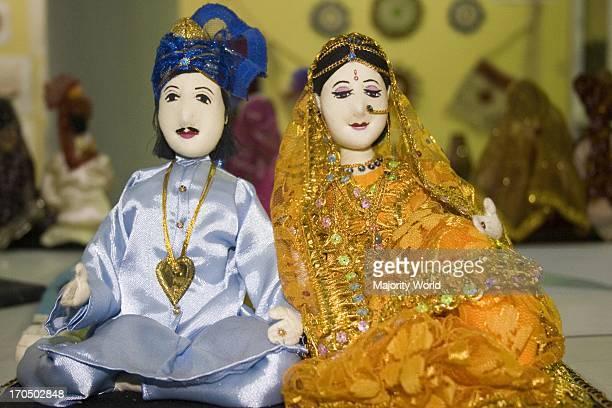 A pair of handmade bride and groom dolls dsaplayed at a fair Dhaka Bangladesh