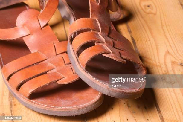pair of hand-made leather sandals - サンダル ストックフォトと画像