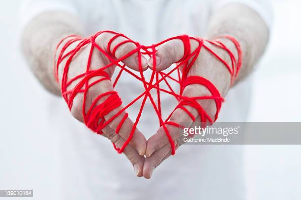 pair of hands in heart shape - catherine macbride stock pictures, royalty-free photos & images