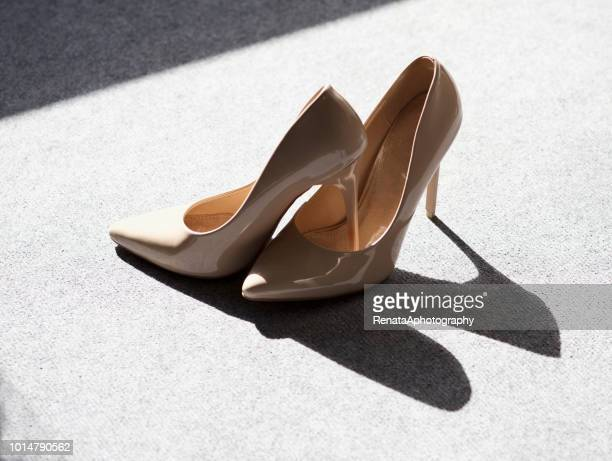 pair of high heel stiletto shoes - stiletto stock pictures, royalty-free photos & images