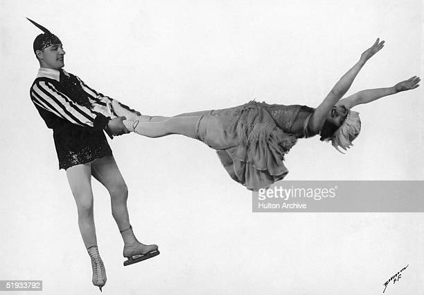 A pair of ice dancers in full swing circa 1925