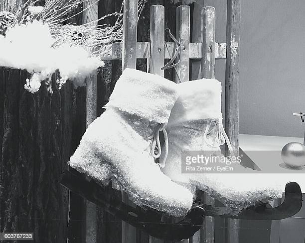 Pair Of Ice Skates Hanging From Fence