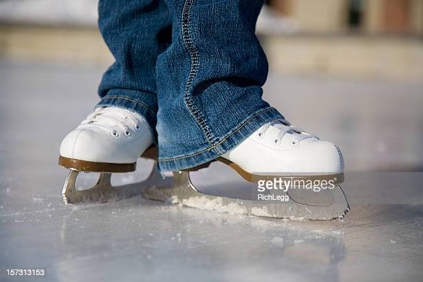 Pair of Ice Skates on Rink
